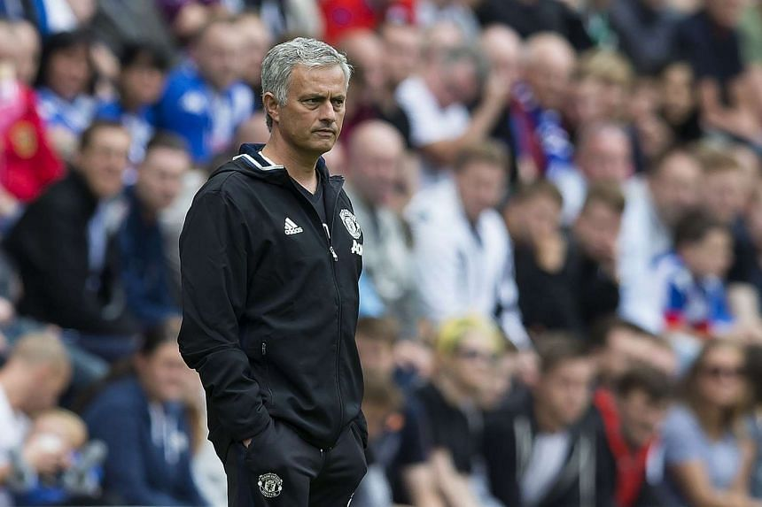 Mourinho watches from the touchline during the pre-season friendly between Wigan Athletic and Manchester United.
