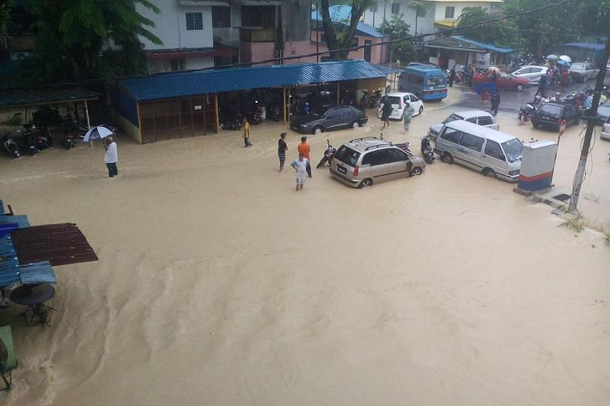 """The Teluk Bahang areas were evacuated due to """"severe flash floods""""."""