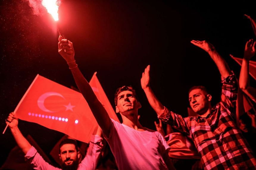 Demonstrators rally at Taksim square in Istanbul on July 17, 2016, in support to the Turkish government, following a failed coup attempt.