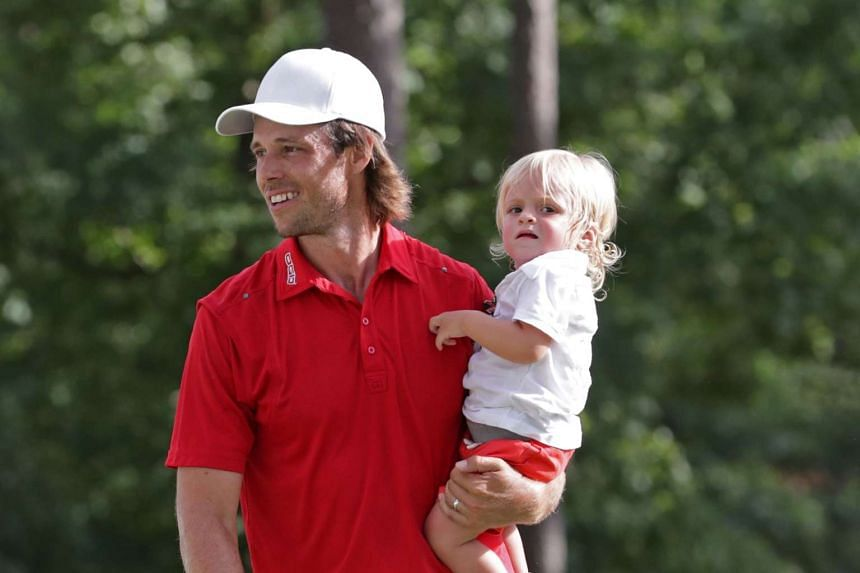 Aaron Baddeley celebrates with his family at the final round of the Barbasol Championship on July 17, 2016, in Auburn, Alabama.