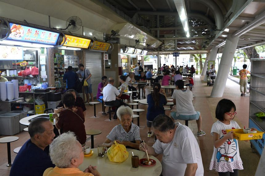 Patrons at Pek Kio Market and Food Centre on May 27, 2016, which reopened after a two-day closure prompted by an outbreak of gastroenteritis cases in the area.