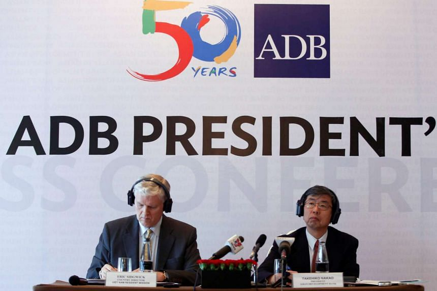 Asian Development Bank (ADB) President Takehiko Nakao (right) and Country Director for Vietnam Eric Sidgwick attend a news conference in Hanoi, Vietnam on June 17.