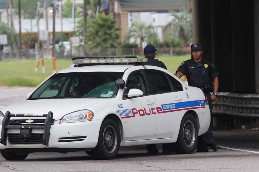 Baton Rouge Police officers block off the roads near where eight police officers were reportedly shot in Baton Rouge, Louisiana, US, July 17.