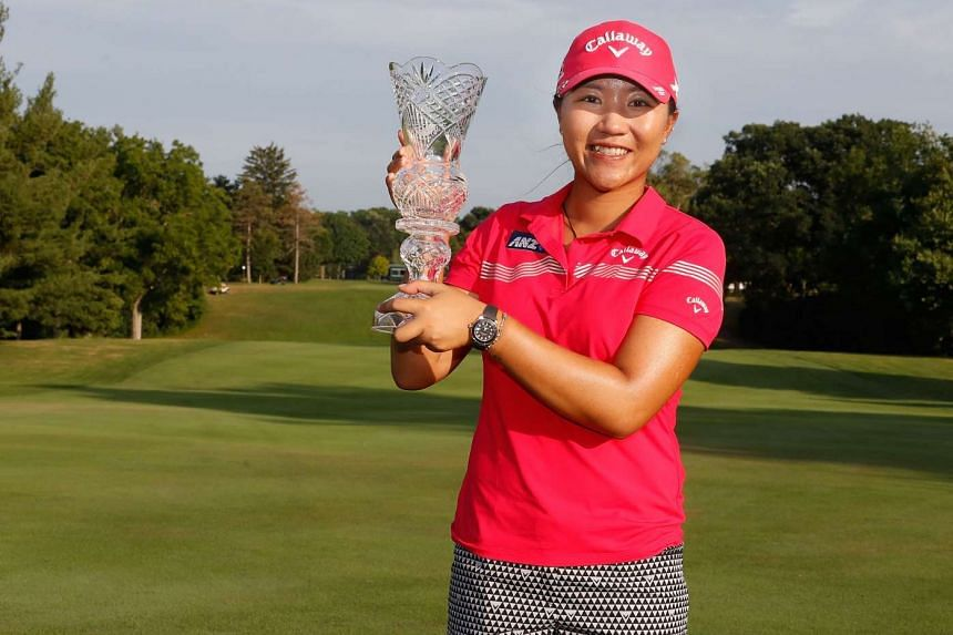 Lydia Ko holds up the championship trophy after winning the Marathon Classic on July 17, 2016, in Sylvania, Ohio.
