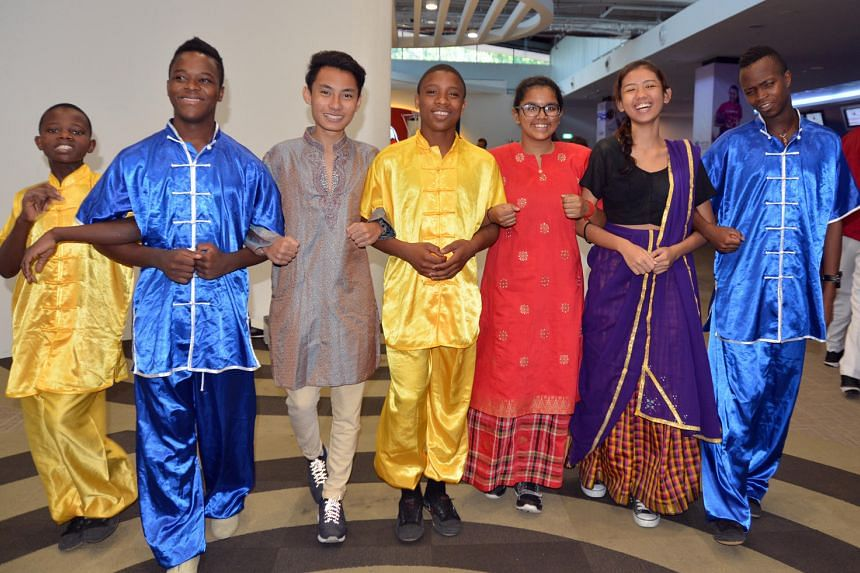 Asean youth leaders in their ethnic costumes celebrate racial harmony at Temasek Club in in Rifle Range Road on July 18, 2016.