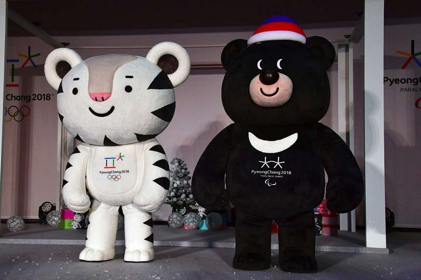 Mascots for South Korea's 2018 Pyeongchang Winter Olympics, a white tiger named Soohorang (left) and an Asiatic black bear named Bandabi at Hoenggye elementary school in Pyeongchang on July 18, 2016.