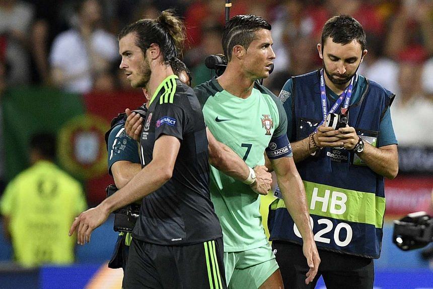 Gareth Bale (left) and Cristiano Ronaldo salute each other at the end of their Euro 2016 semi-final football match between Portugal and Wales, on July 6, 2016.
