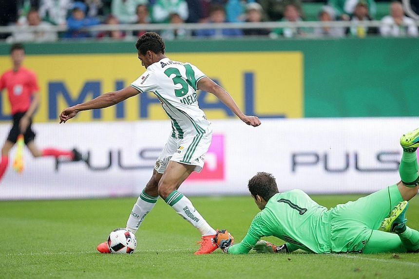 Joelinton rounding Chelsea goalkeeper Asmir Begovic to score Rapid Vienna's opener in their friendly. New coach Antonio Conte knows the Blues have a lot to do to get ready for the new season.