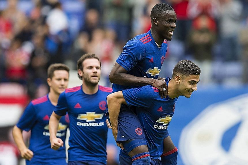 Andreas Pereira (right) with Eric Bailly after scoring United's second goal, as Juan Mata joins in the celebrations.