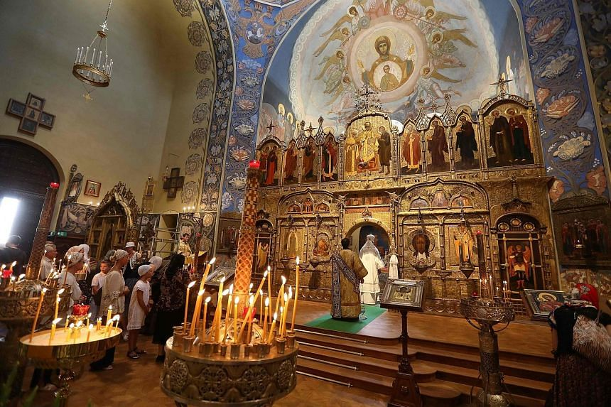 Candles lit for the victims of the Bastille Day attack during a mass at the St Nicholas Orthodox Cathedral in Nice yesterday. Eighty-four people were killed in the truck attack.