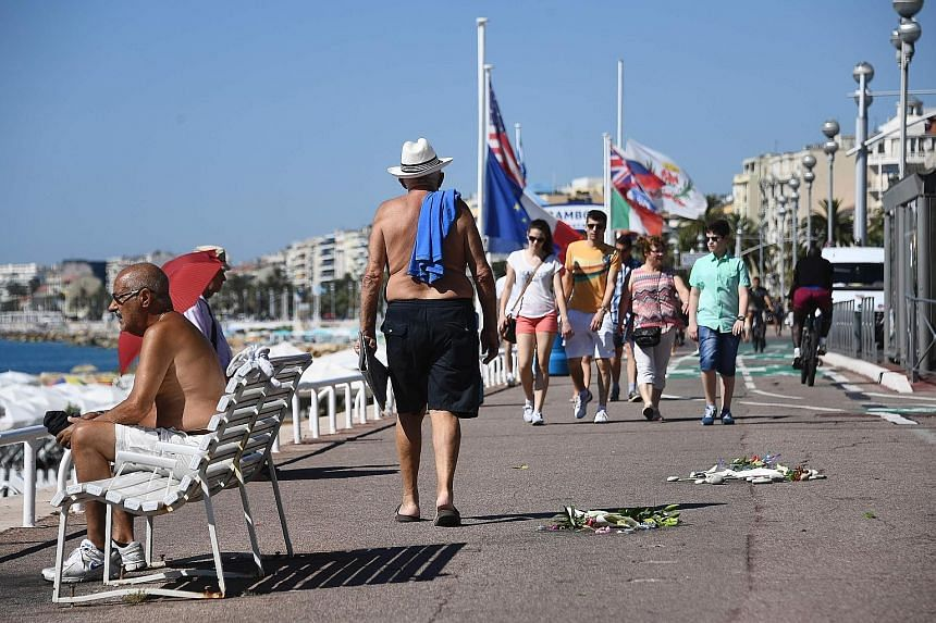 Flowers left as tributes to the victims of last Thursday's attack on the Promenade des Anglais in Nice yesterday.