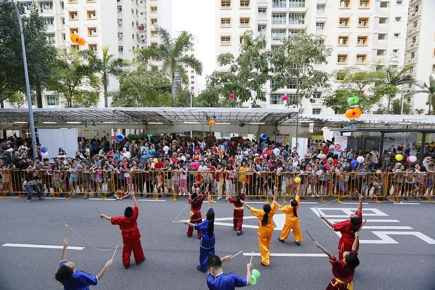 Children performing at the 12th Punggol North Racial and Religious Harmony Street Parade and Family Carnival, attended by some 12,000 residents, in Punggol Field Road yesterday.