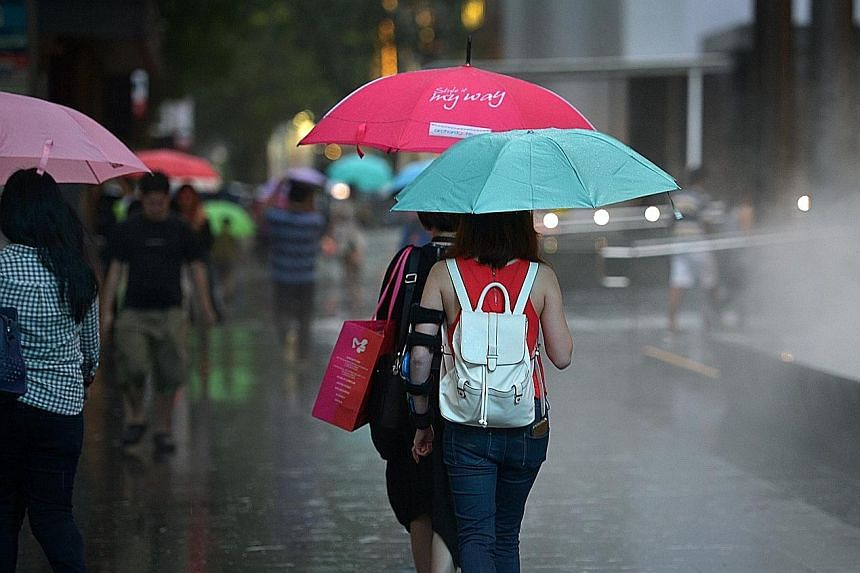 Just like these shoppers caught in the rain, mall landlords in Singapore are also facing gloomy weather, as e-commerce growth outpaces retail sales.