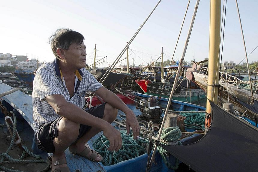 Fisherman Fu Zhongzheng, 68, on China's Hainan Island preparing to sail into the South China Sea, despite an arbitral tribunal ruling last week that struck down China's historical claims to most of the maritime region. The determination of both Chine