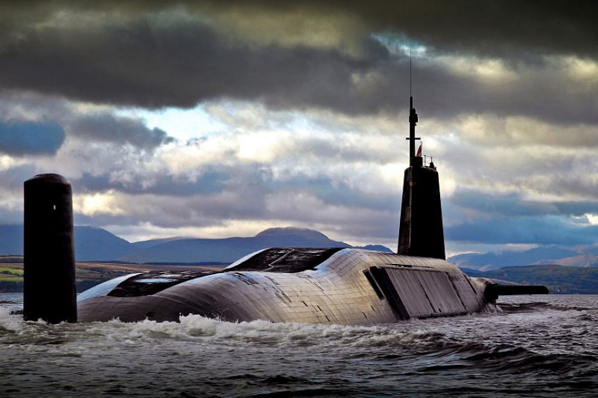 The HMS Vengeance, one of Britain's submarines that is armed with the Trident nuclear system, returning to Naval Base Clyde.
