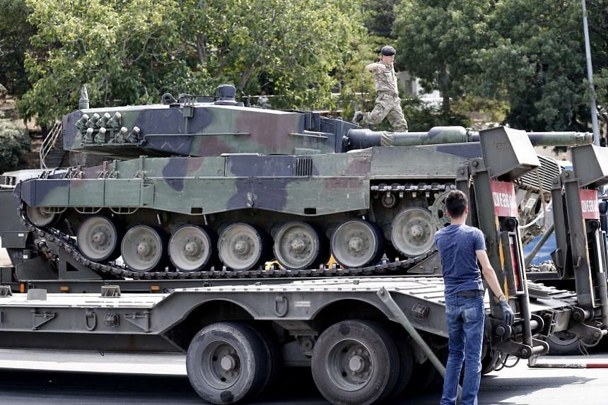 Turkish soldiers loading the tanks on to transporters to return them to military bases, in Istanbul, following a failed coup attempt, on July 17, 2016.