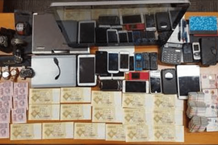 Police seized cash of more than $650,000, computer equipment and other items possibly used to facilitate illegal gambling activities.