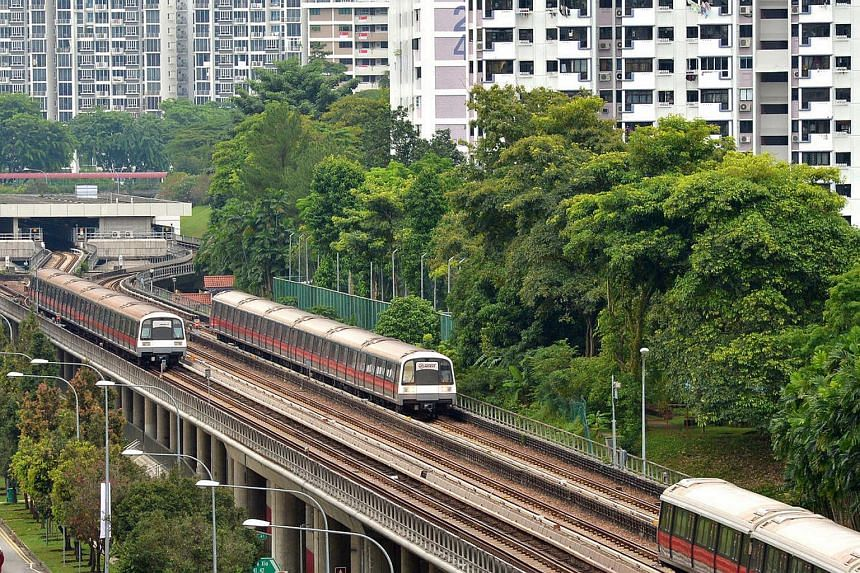 SMRT trains seen moving along Ang Mo Kio Ave 10 on July 15.