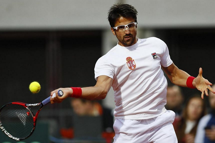Serbia's Janko Tipsarevic in action during his singles match against Great Britain's James Ward.
