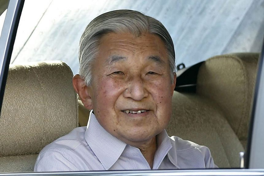 Japan's Emperor Akihito smiles to well-wishers as he leaves the Hayama Imperial Villa in an imperial limousine in Kanazawa Prefecture, on July 14, 2016.