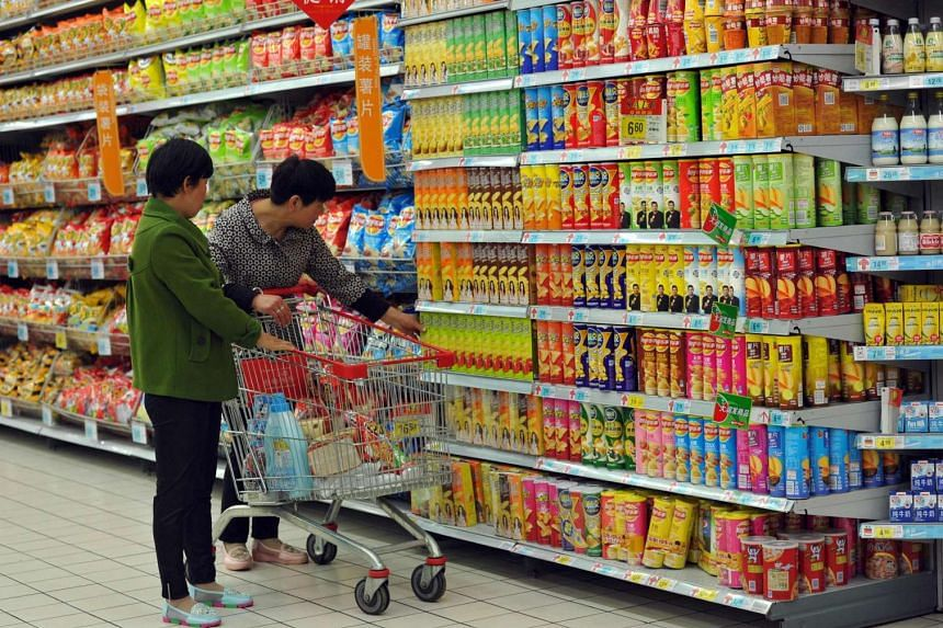 Customers select snacks at a supermarket in Fuyang, in eastern China's Anhui province on May 10.