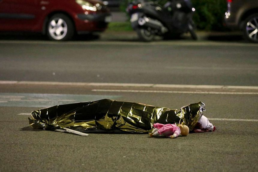 A body is seen on the ground July 15, 2016 after 84 people were killed in Nice, France, when a truck ran into a crowd celebrating the Bastille Day national holiday July 14.