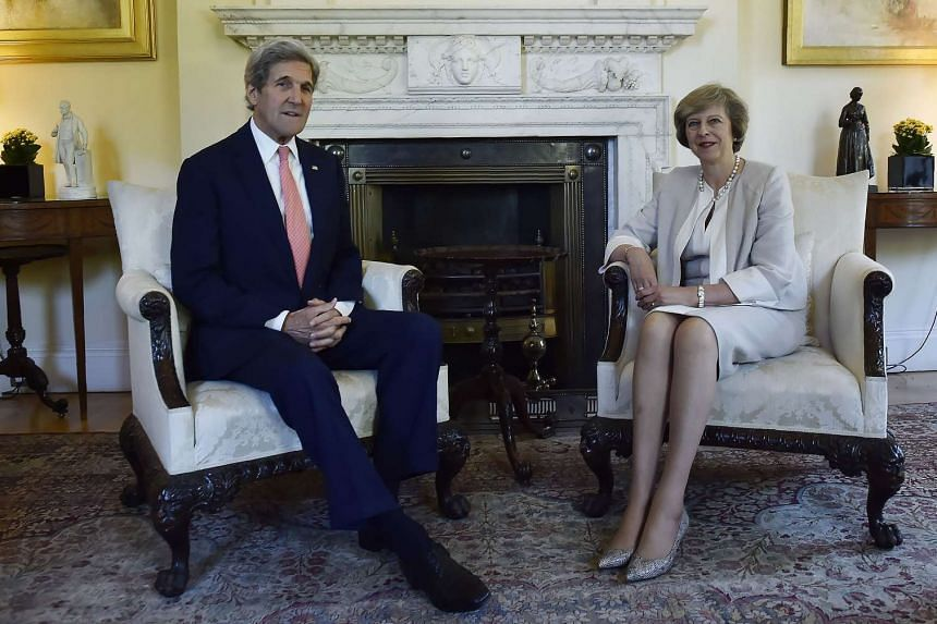 US Secretary of State John Kerry (left) and British Prime Minister Theresa May inside 10 Downing Street in London on July 19, 2016.