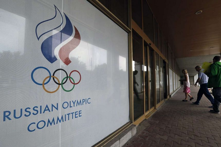 People enter the Russian Olympic Committee headquarters and Russian Athletics Federation office in Moscow, on July 19, 2016.