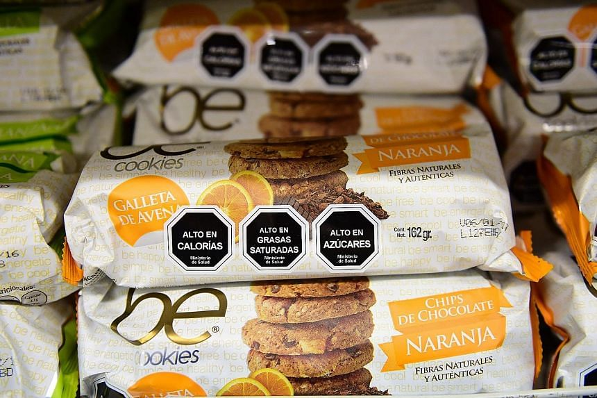 Cookies with labels stating their high content of sugar, calories and saturated fat in Santiago, Chile.