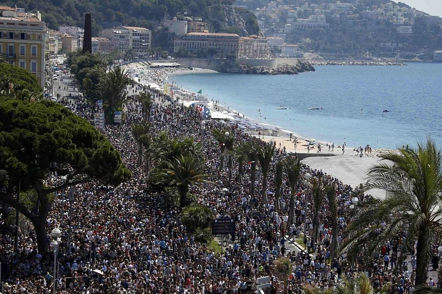 A sea of people thronging the beach promenade in the French Riviera city of Nice for an emotional minute's silence yesterday, four days after a Tunisian attacker drove a truck into a crowd at the same place on France's national day, killing 84 people