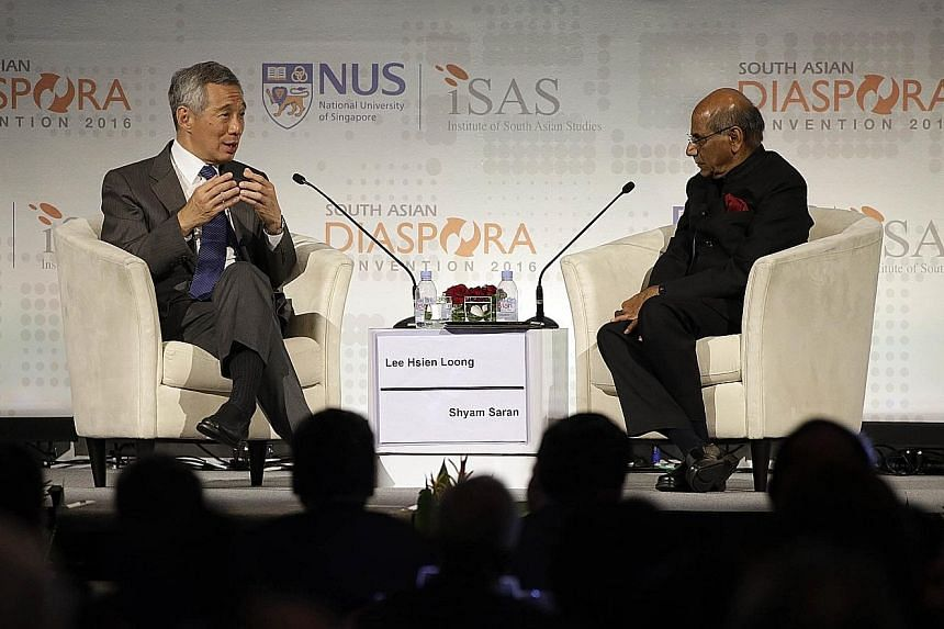PM Lee speaking at the South Asian Diaspora Convention's gala dinner yesterday. The dialogue was moderated by Mr Shyam Saran, the former foreign secretary of India.