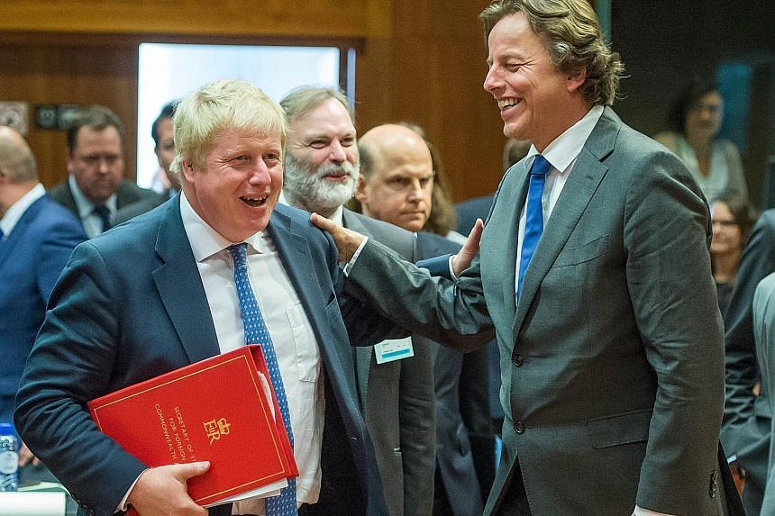 British Foreign Secretary Mr Johnson (left) with Dutch Foreign Minister Bert Koenders at an EU meeting in Brussels yesterday.
