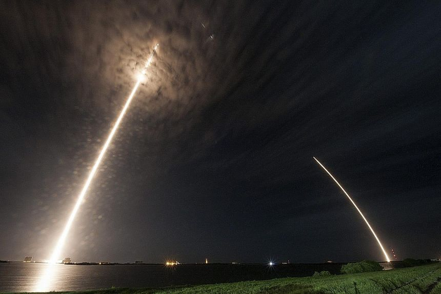 The SpaceX Falcon 9 rocket and Dragon spacecraft lifting off from Cape Canaveral Air Force Station yesterday. The main section of the Falcon 9 rocket later separated from the Dragon spacecraft and flew itself back to the ground.