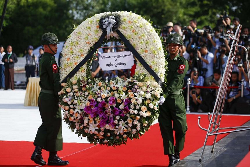 Soldiers carry the wreath to pay homage to late General Aung San and leaders of the pre-independence Myanmar government during the 69th Martyrs' Day ceremony on July 19.