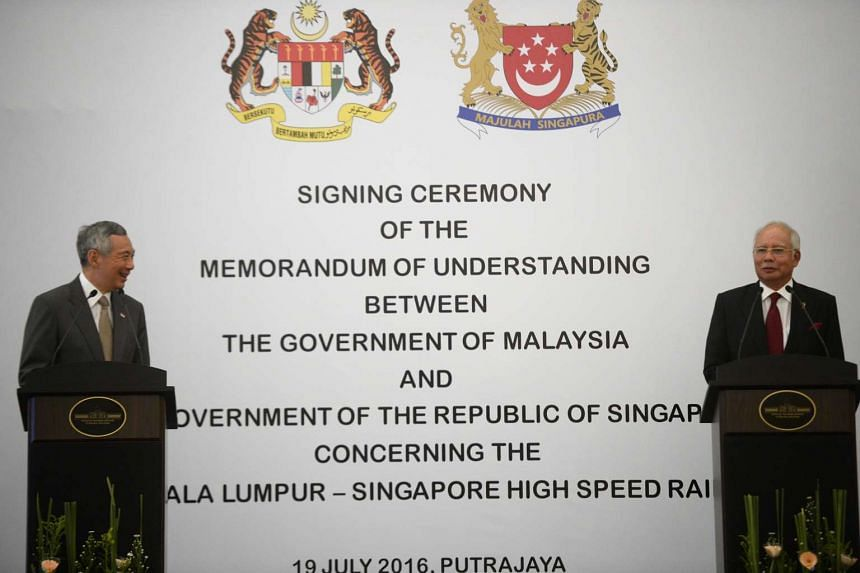 Singaporean Prime Minister Lee Hsien Loong (left) and Malaysian Prime Minister Najib Abdul Razak attend a press conference during the signing of the HSR MOU in Putrajaya, Malaysia, on July 19, 2016.