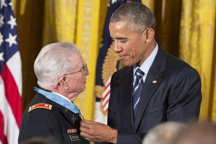 Vietnam War veteran Army Lieutenant Colonel Charles Kettles speaks with US President Barack Obama after he was presented with the Medal of Honor at the White House in Washington, on July 18.