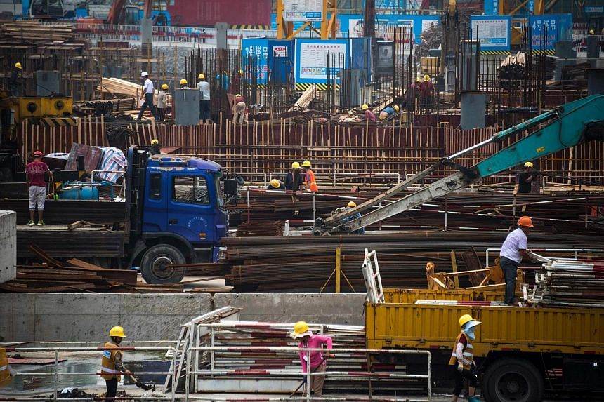 Employees work on a construction site in Shanghai.