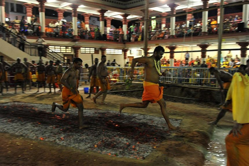 Devotees at the annual firewalking festival at the Sri Mariammam Temple in South Bridge Road in 2011.