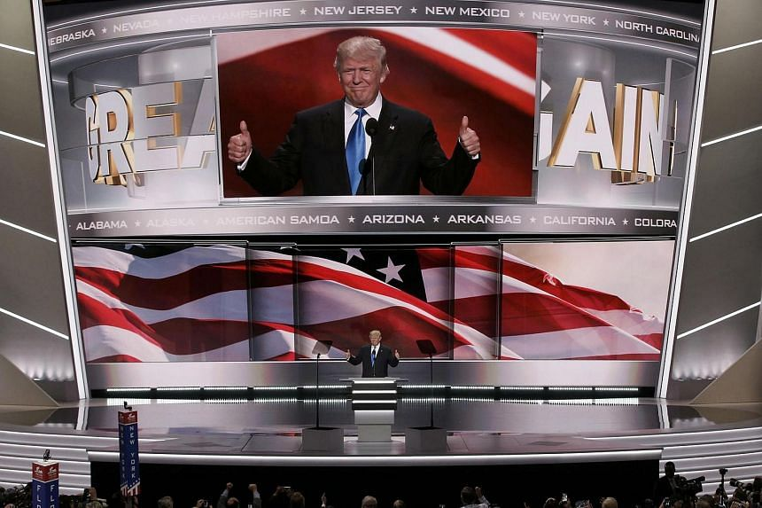 Republican US Presidential candidate Donald Trump appears on stage to introduce his wife Melania at the Republican National Convention in Cleveland, Ohio, July 18.