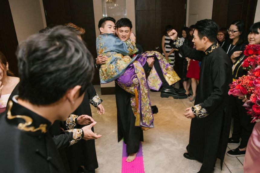 Actor Chen Xiao being carried by groomsman Feng Qilong, during his wedding celebrations to Taiwanese actress Michelle Chen, on July 19, 2016.