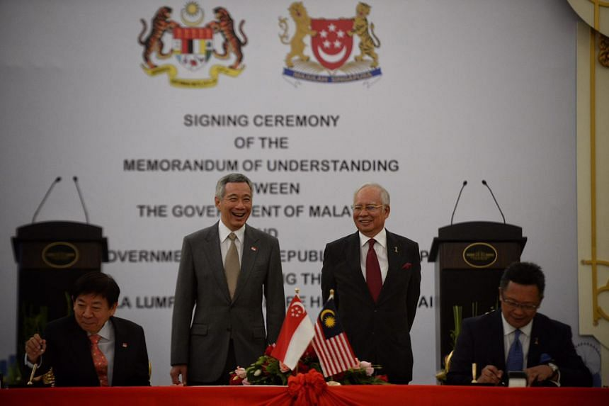 (From left) Singapore's Transport Minister Khaw Boon Wan and PM Lee Hsien Loong, and Malaysia's PM Najib Razak Minister in the Prime Minister's Department Abdul Rahman Dahlan during the signing of the MOU, on July 19, 2016.