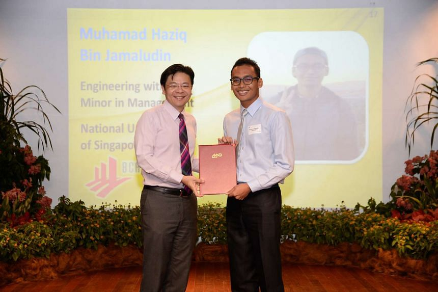Mr Muhamad Haziq Jamaludin being presented with his certificate by Minister for National Development Lawrence Wong, at the MND EDGE Scholarship ceremony on July 19, 2016.
