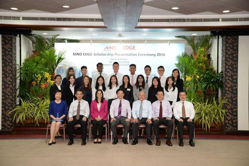 MND EDGE scholarship recipients with Minister for National Development Lawrence Wong during the scholarship ceremony at MND Building on July 19, 2016.
