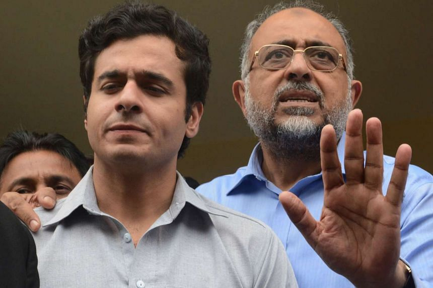 Pakistan Sindh High Court Chief Justice Sajjad Ali Shah (right) speaking to media with his son Awais Ali Shah, in Karachi on July 19, 2016.