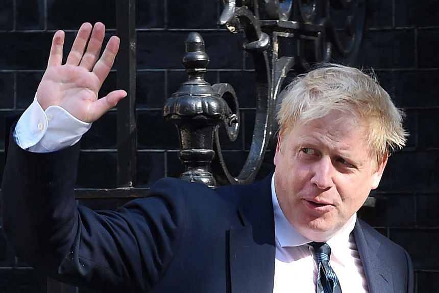 British Secretary of State for Foreign and Commonwealth Affairs Boris Johnson waving as he arrives for a Cabinet meeting at 10 Downing Street on July 19, 2016.