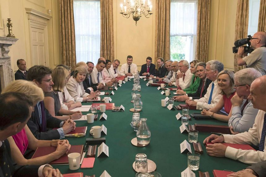 British Prime Minister Theresa May (left side, centre) holding her first Cabinet Meeting at Downing Street, in London, on July 19, 2016.