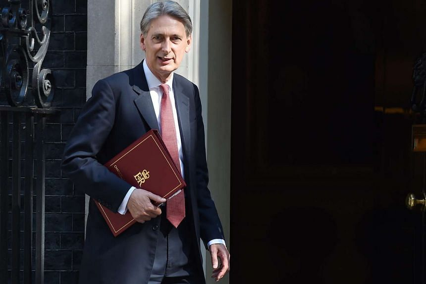 British Chancellor of the Exchequer Philip Hammond arriving for a Cabinet meeting at 10 Downing Street on July 19, 2016.