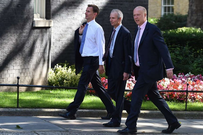 (From left) Health Secretary Jeremy Hunt, Leader of the House of Commons David Lidington and Secretary of State for Transport Chris Grayling arriving for a Cabinet meeting on July 19, 2016.