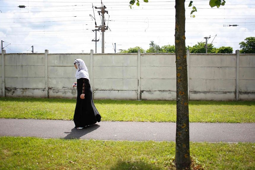 A Muslim woman walking on June 19, 2016 in Mantes-la-Jolie, in north-central France.