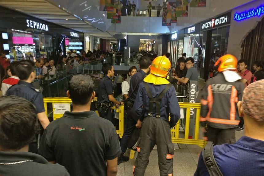 Firefighters cordon off an area at Jem shopping mall on July 19, 2016.